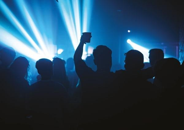 Silhouette of people at a music event.