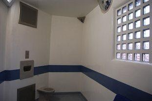 Police station cell with toilet.