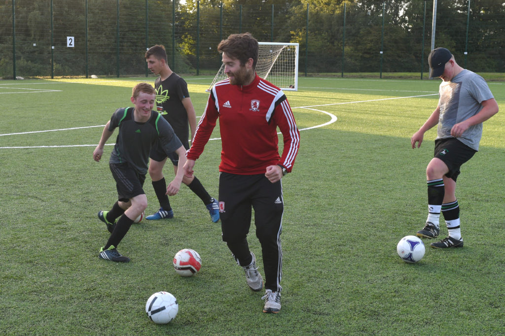 boys playing football at MFC foundations kick course