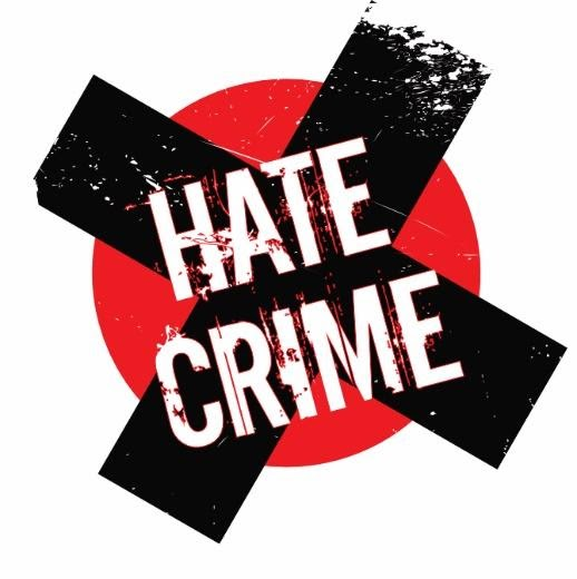 hate crime logo, with a black cross on a red circle.