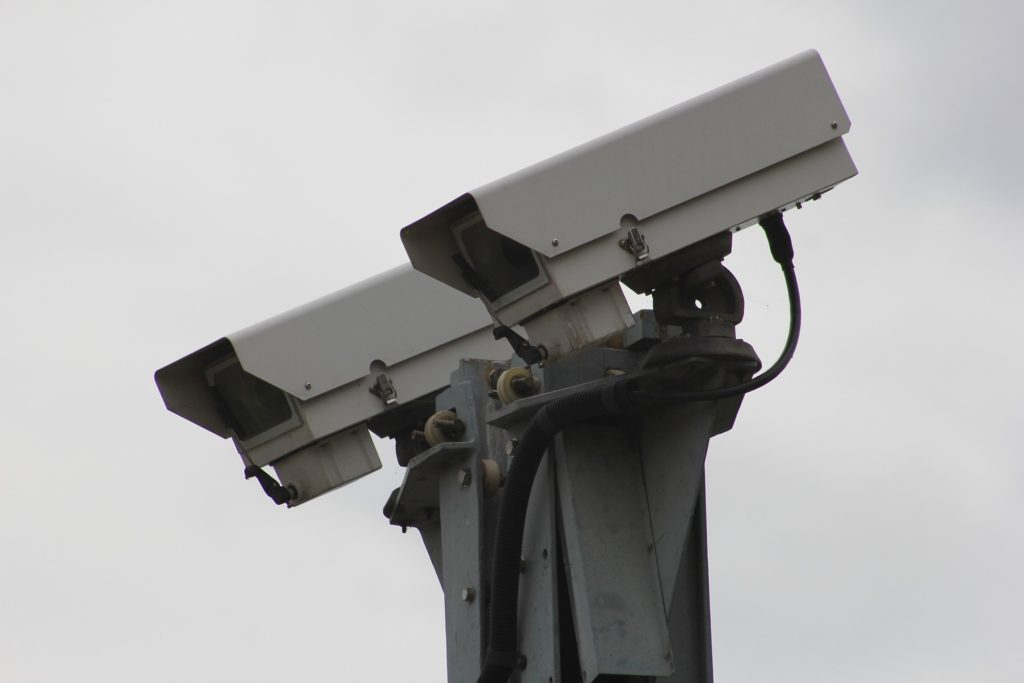 Two CCTV cameras pointing downwards