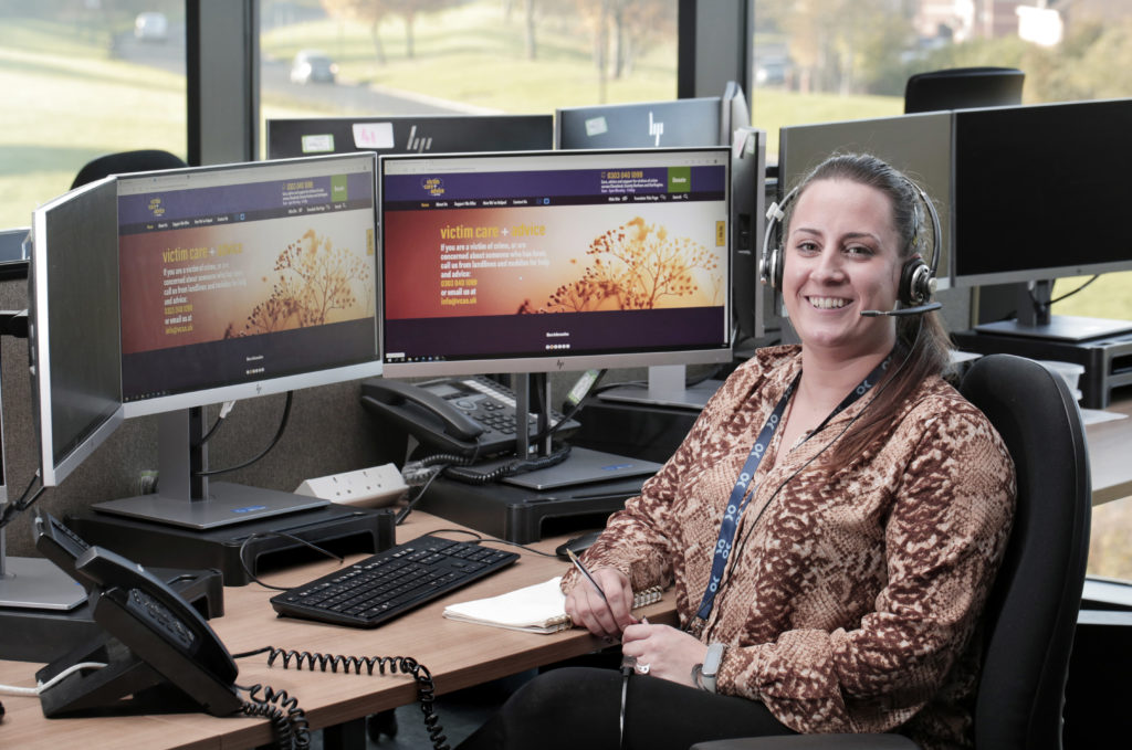 Victim Care Officer Sam Harrison sat at a computer in police control room